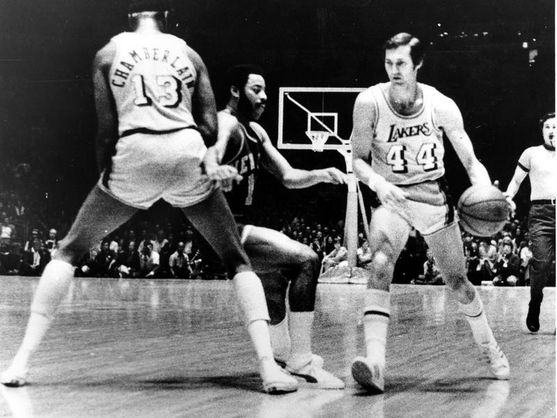 Jerry West drives around pick