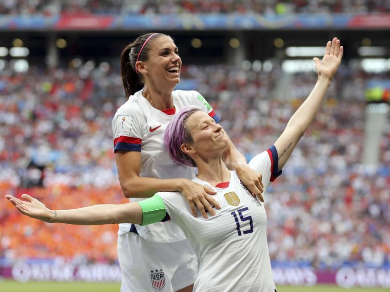 Megan Rapinoe celebrating