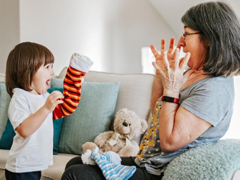 Child playing with socks