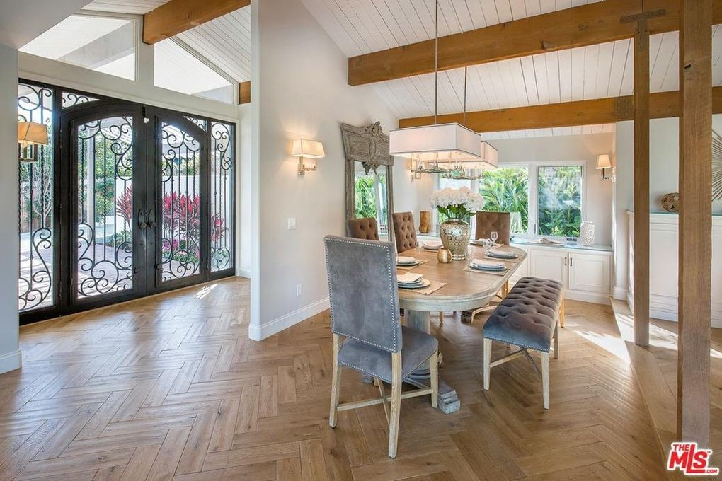 Dining room with large front doors