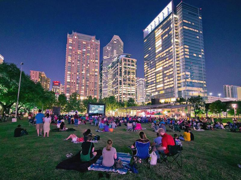 People sitting and watching a movie in Discovery Green
