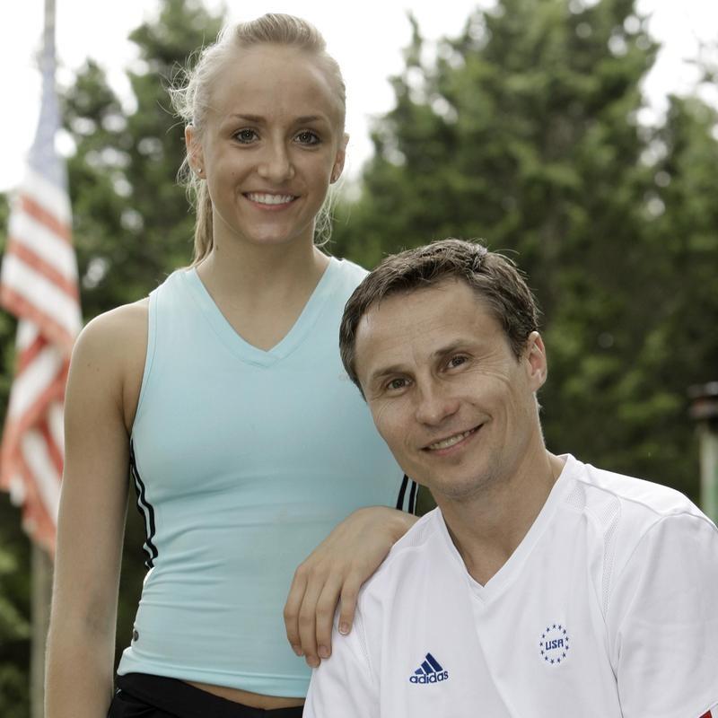 Nastia Liukin poses with coach and father Valeri Liukin at Karolyi's Camp