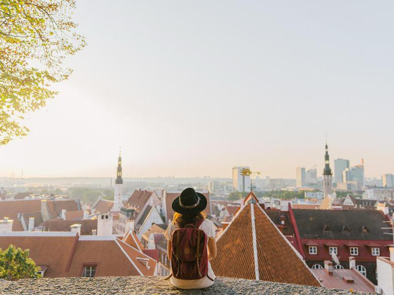 Woman sitting and looking at Tallinn in the morning