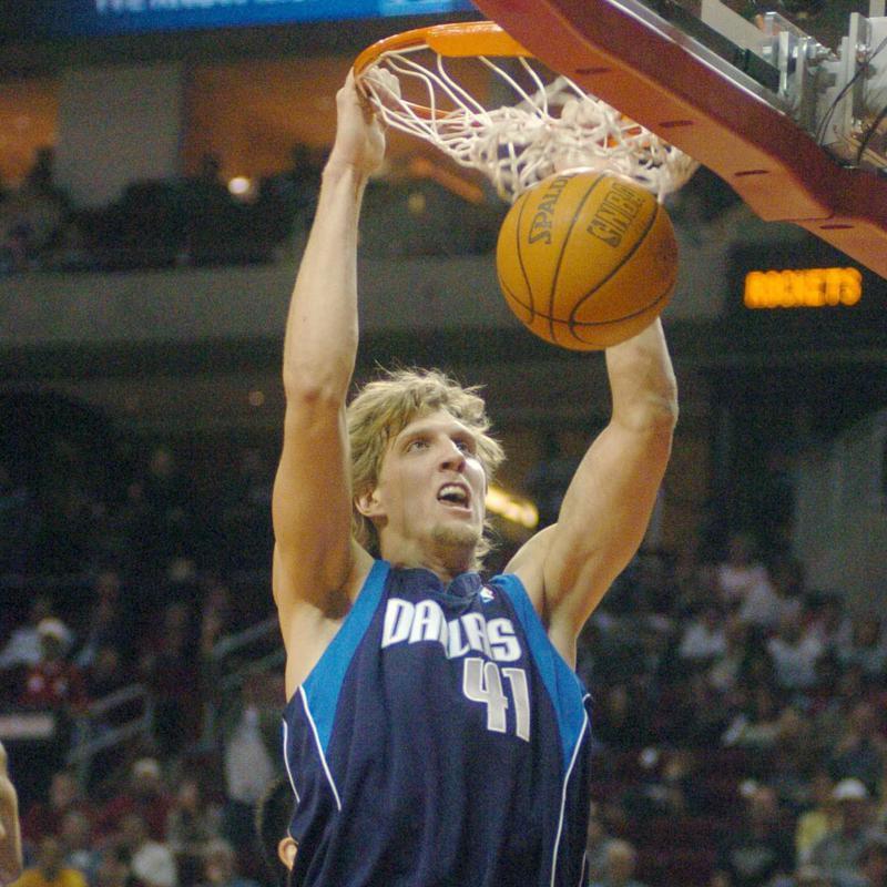 Dallas Mavericks' Dirk Nowitzk slam dunks ball