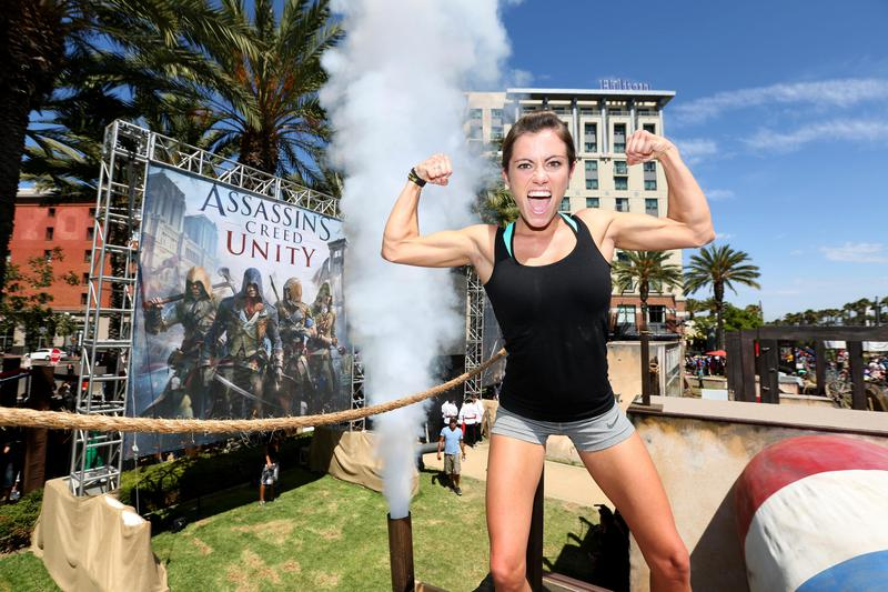 """Kacy Catanzaro, then of """"American Ninja Warrior,"""" celebrates completing the parkour course at Comic-Con in San Diego in 2014. Catanzaro has since joined the WWE."""