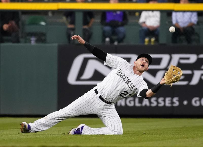 Trevor Story dives to catch ball against Phillies