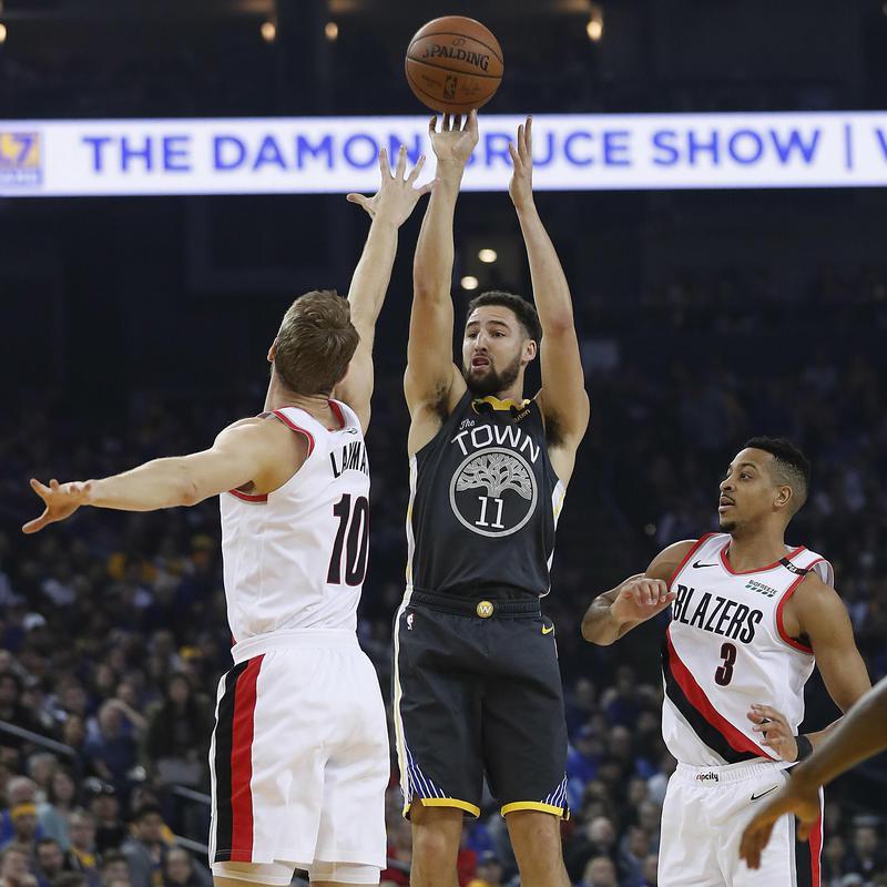 Klay Thompson takes 3-point shot over Portland Trail Blazers