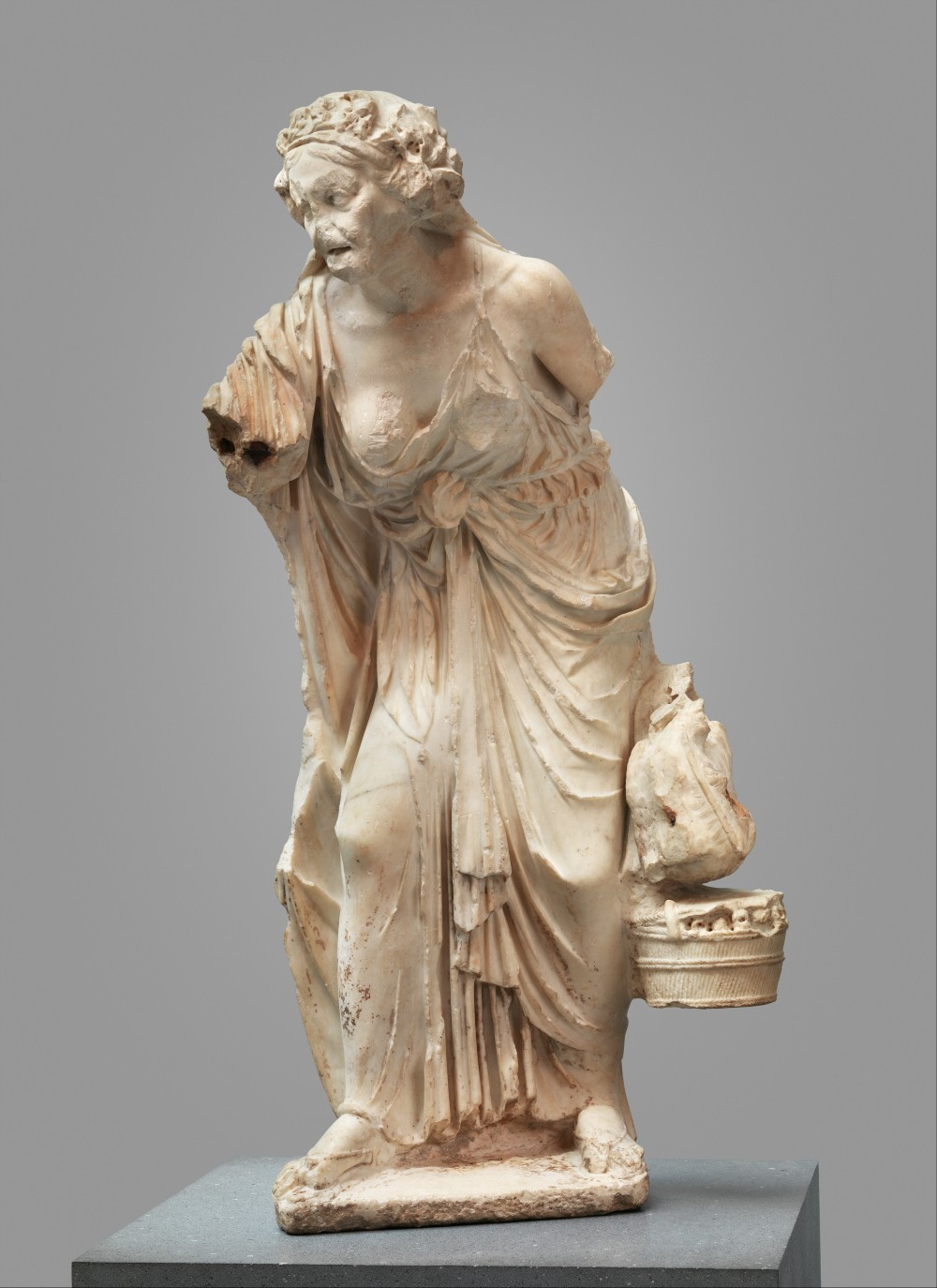 Ancient roman statue of an old woman