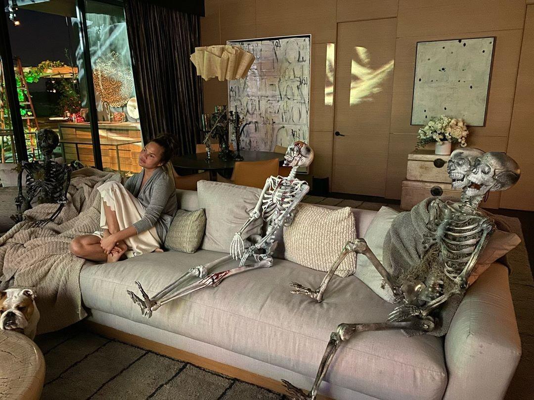 Chrissy Teigen with some skeletons