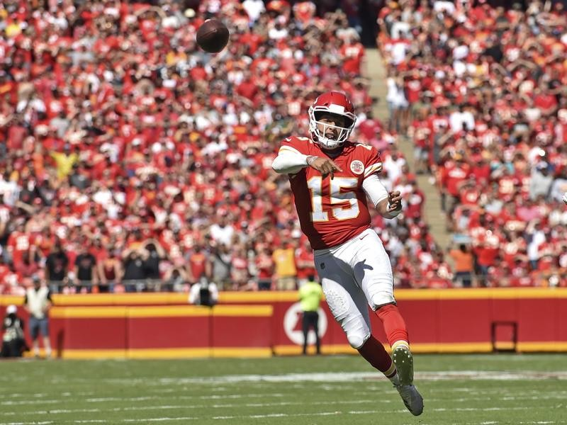 Patrick Mahomes throws a touchdown pass against the San Francisco 49ers