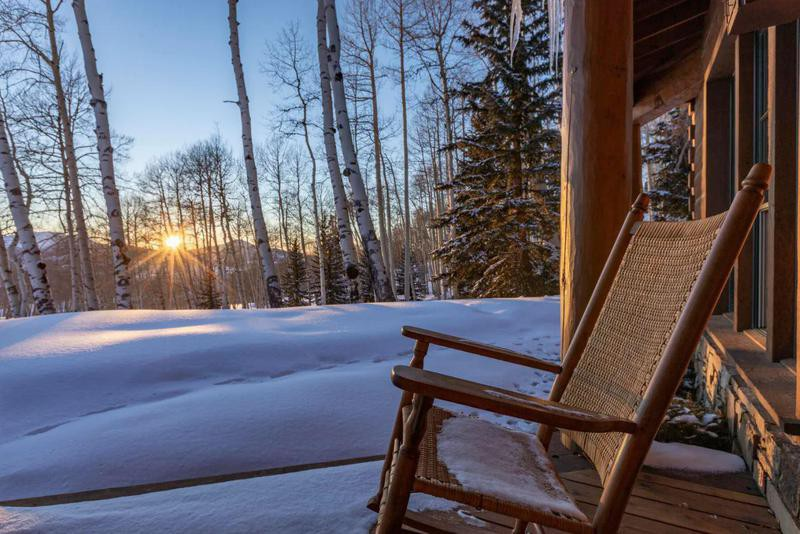 Wood rocking chair with a snow background