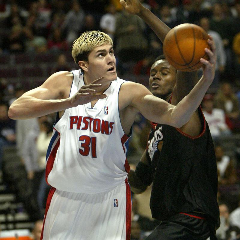 Detroit Pistons' Darko Milicic drives past Samuel Dalembert