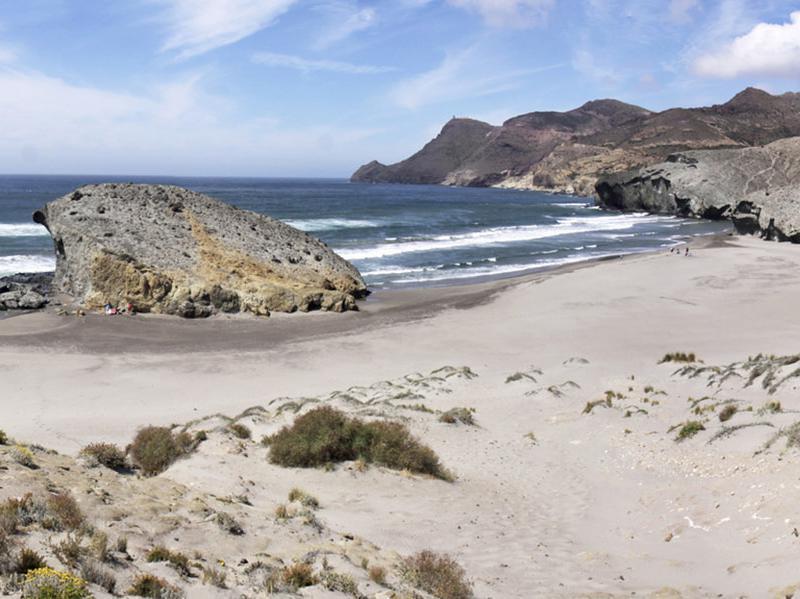 Wide view of dunes and beach of Playa de Monsul