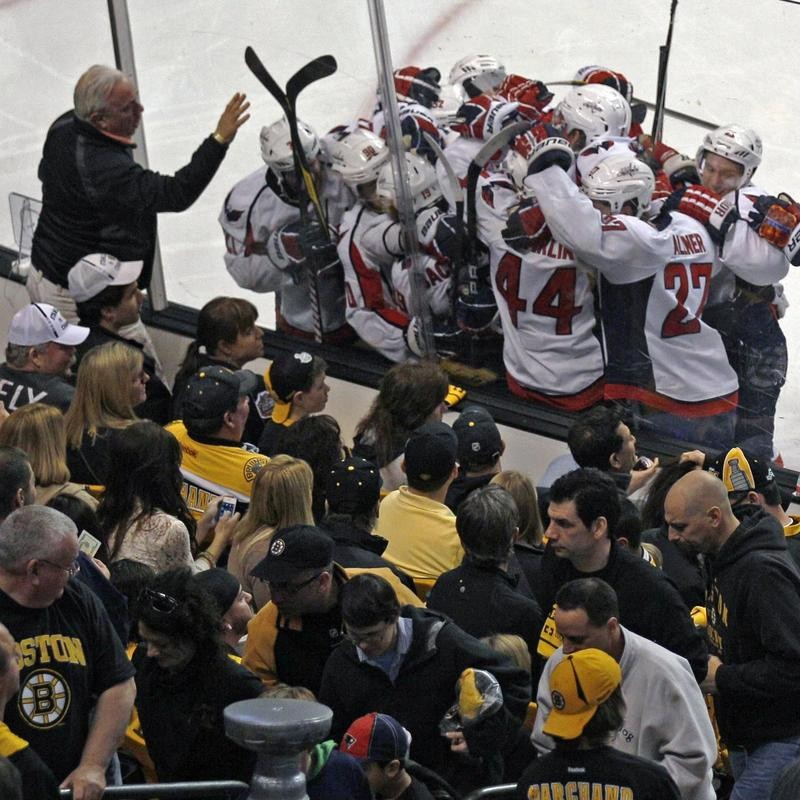 Washington Capitals surround Nicklas Backstrom to celebrate