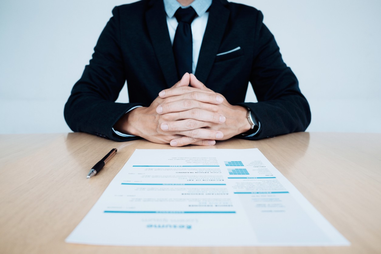 Business job interview with resume on the table