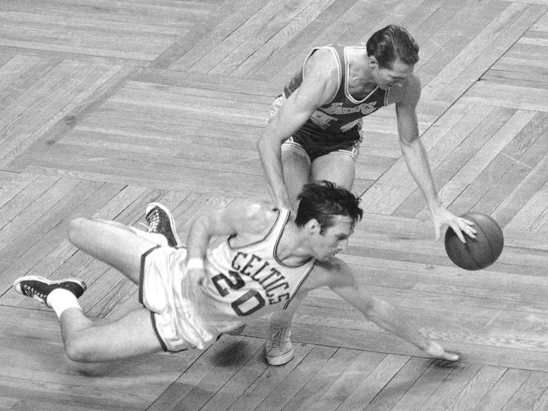 Los Angeles Lakers' Jerry West picks up loose ball