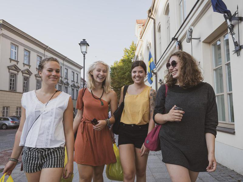 Young women walking in Old Town of Vilnius, Lithuania
