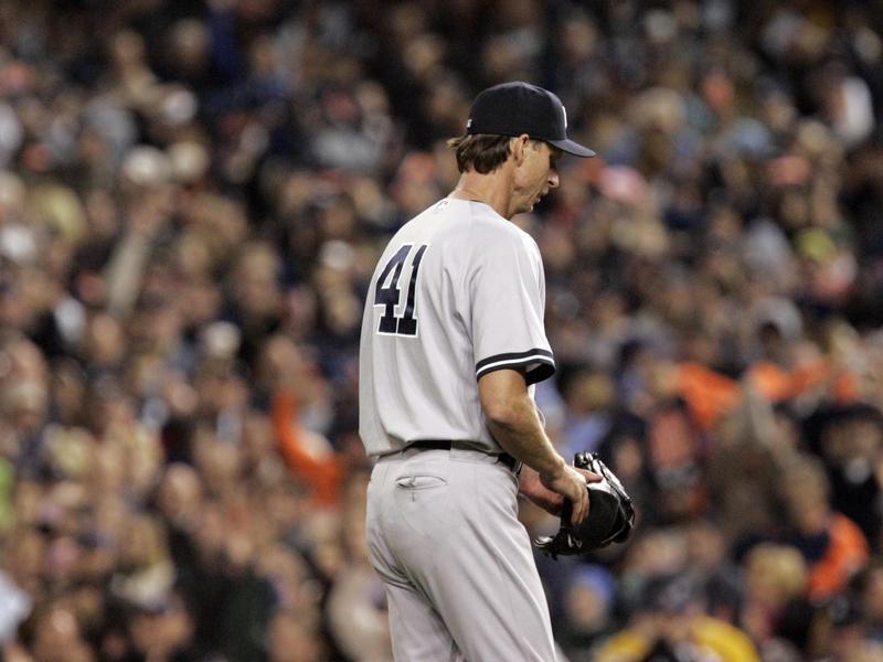 New York Yankees starting pitcher Randy Johnson walks off field