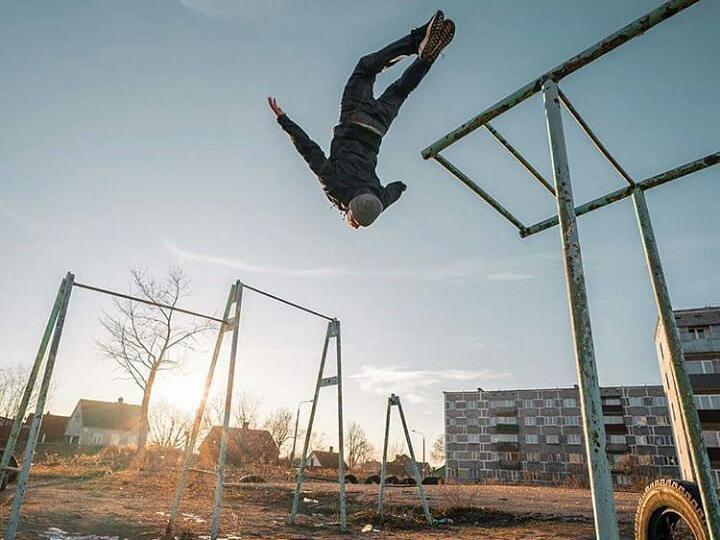 Man jumping off bars