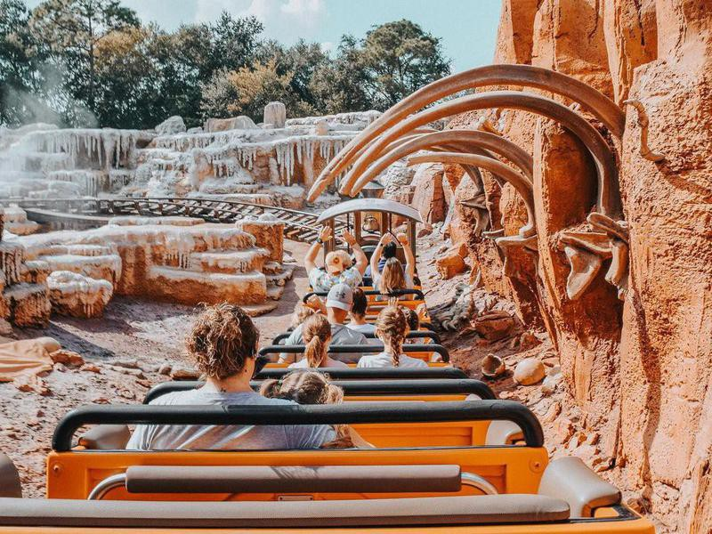 Tourists in ride at Disney World