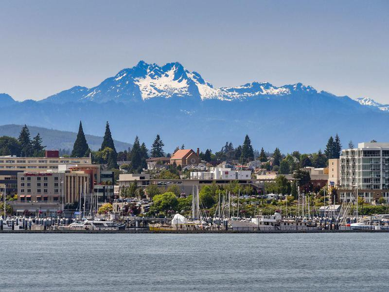 Waterfront of Bremerton, WA, with snow capped mountains in the background