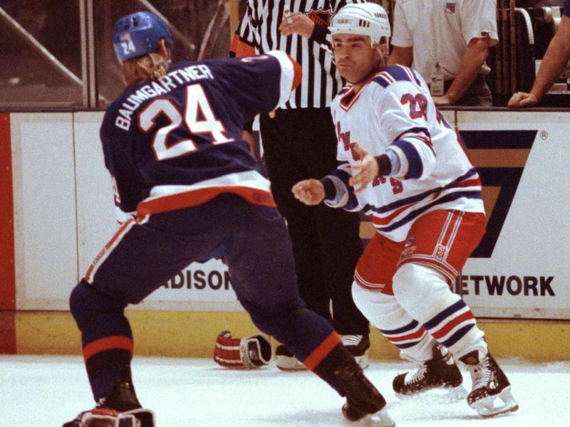 Tie Domi squares off with New York Islanders Ken Baumgartner during game at Madison Square Garden