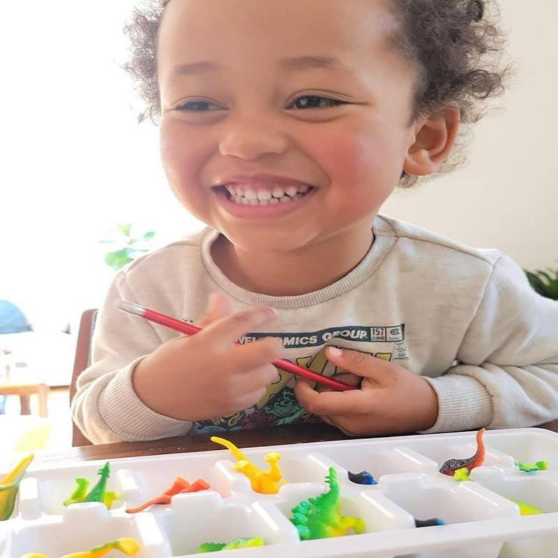 Toddler playing with ice cube tray