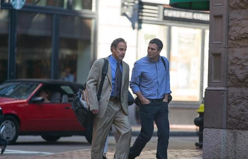 Stanley Tucci and Mark Ruffalo walking and conversing in Spotlight