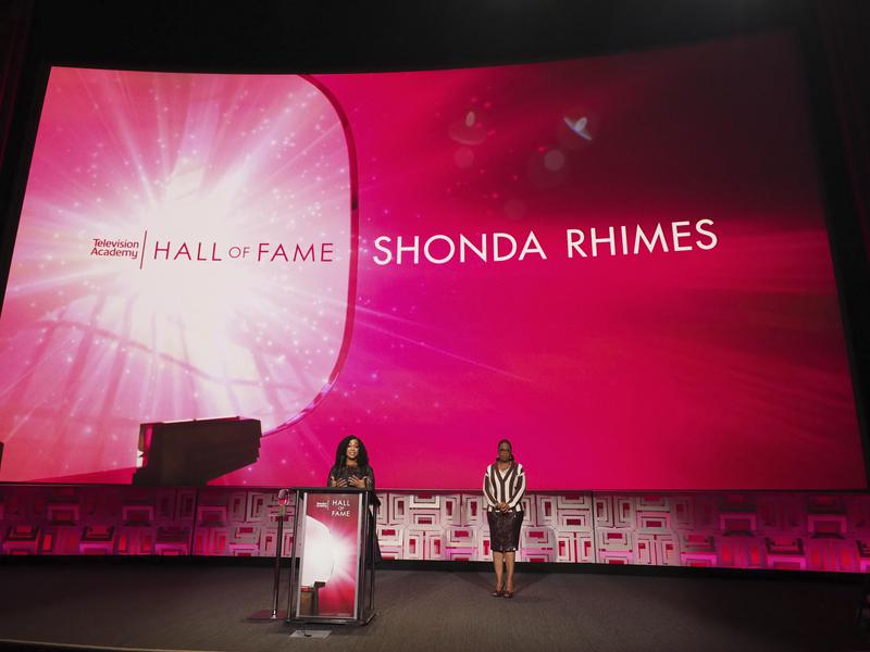 Rhimes's efforts resulted in her induction into the Television Academy Hall of Fame in  2017. Yes, that Oprah Winfrey behind her on stage.