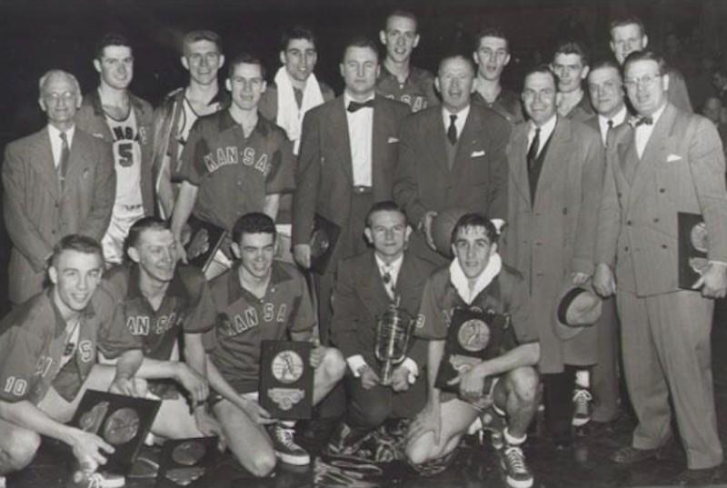 Kansas Jayhawks pose with trophy