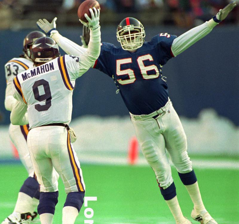r Lawrence Taylor pressures Minnesota Vikings quarterback Jim McMahon