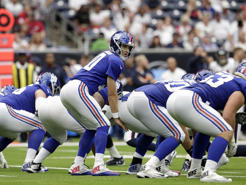 Eli Manning and Giants offensive line