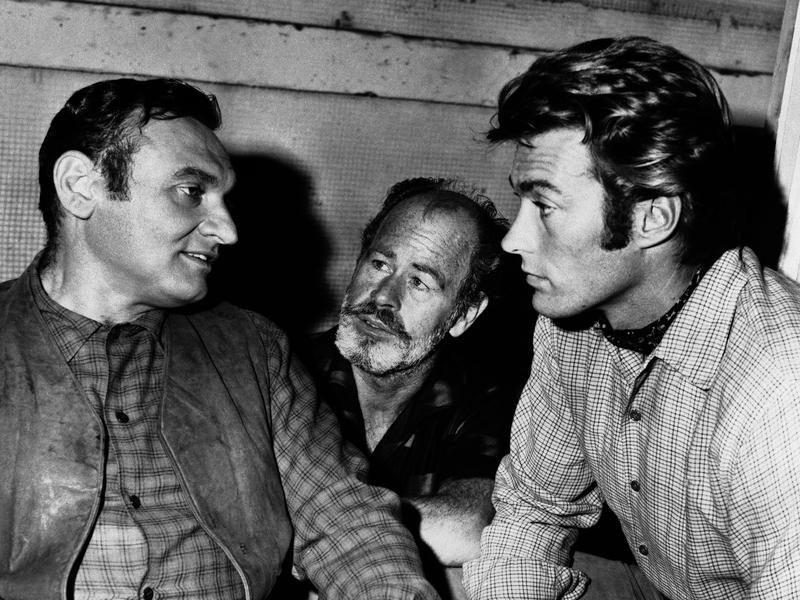 """Clint Eastwood performs with Frankie Lane (left), and Paul Brinegar on the set of """"Rawhide"""" in 1961. By the end of the show's run, Eastwood was making $100,000 per season."""
