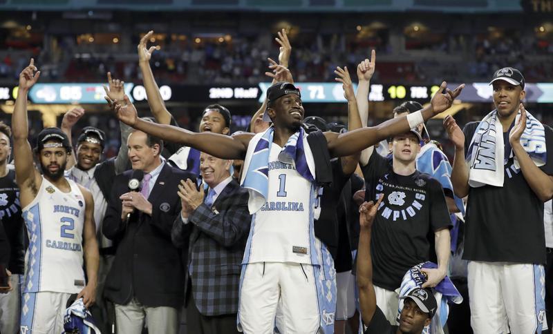 North Carolina's Theo Pinson and teammates celebrate
