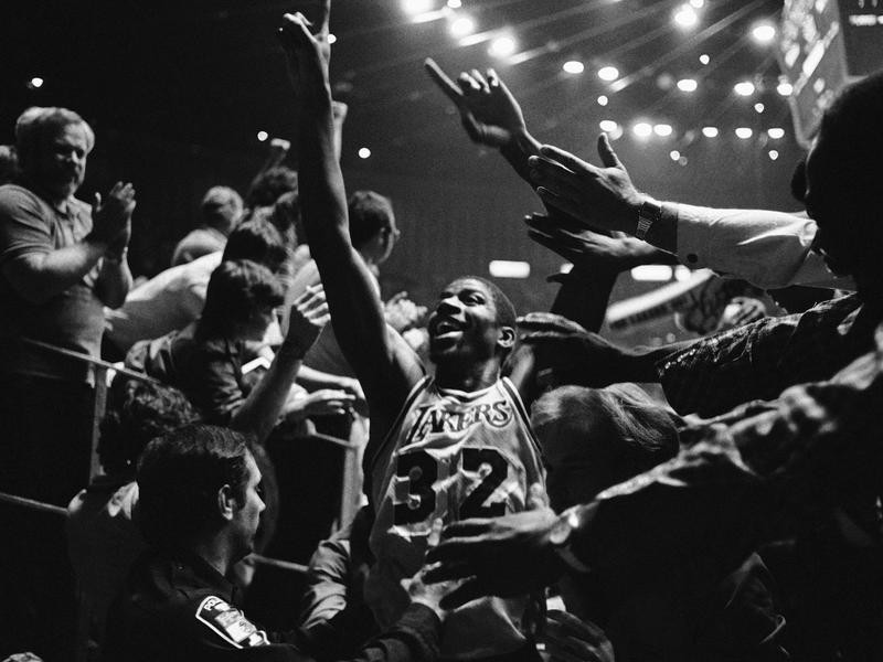 Magic Johnson celebrates with crowd