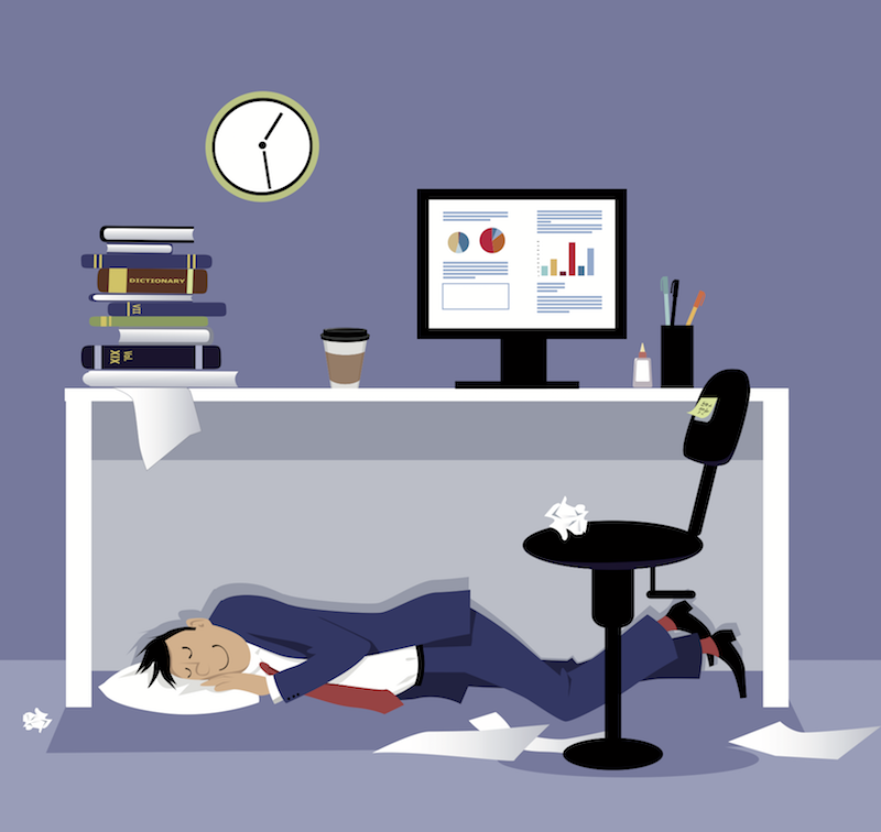 lazy worker sleeping under desk