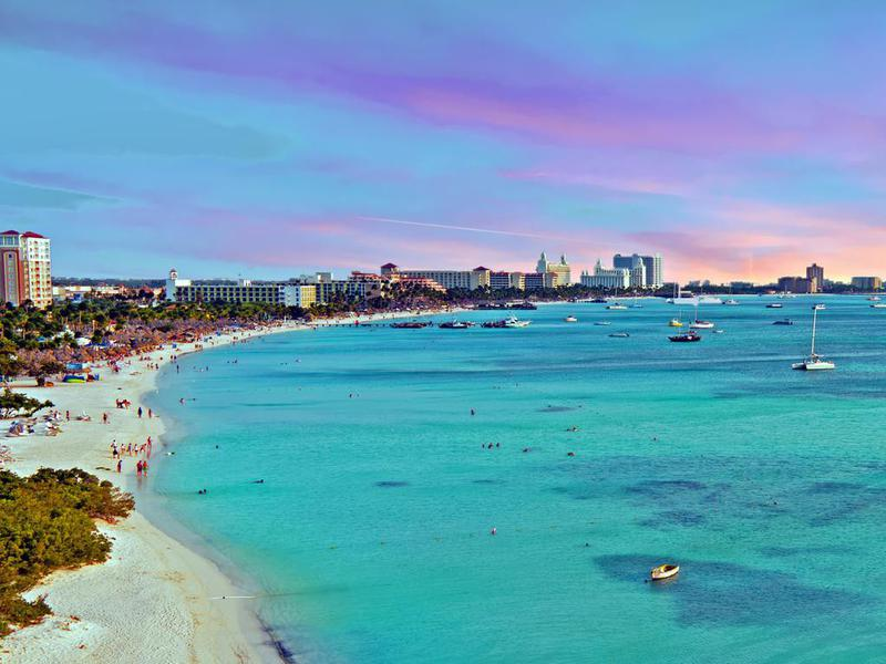 View on Palm Beach at Aruba Island in the Caribbean Sea at sunset