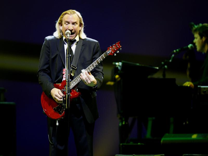 Joe Walsh, shown performing with The Eagles in 2009, made his mark outside that band with an ode to excess.