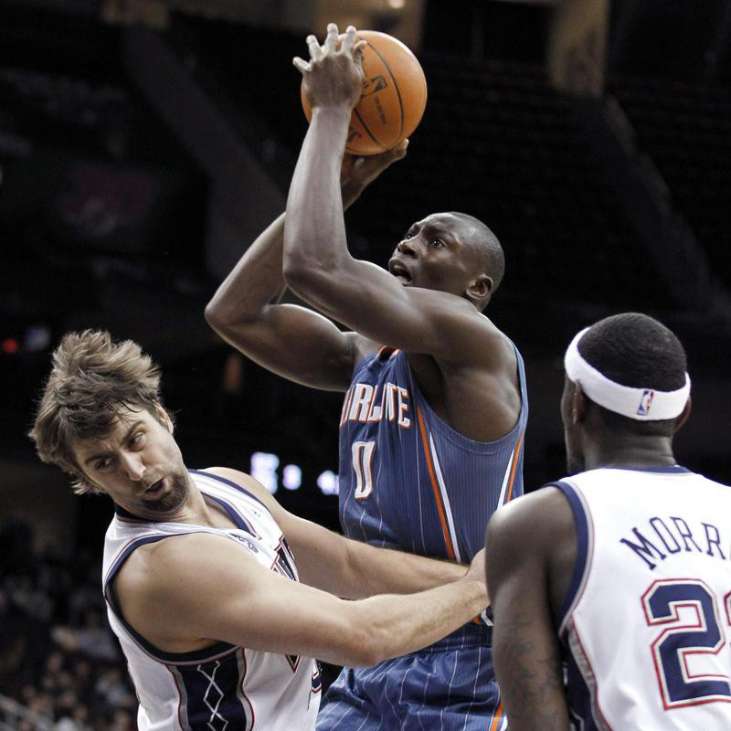 Bismack Biyombo toes up for shot against New Jersey Nets' Mehmet Okur