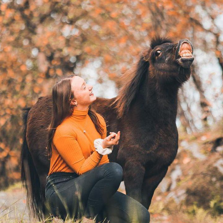 Girl Posing with Horse