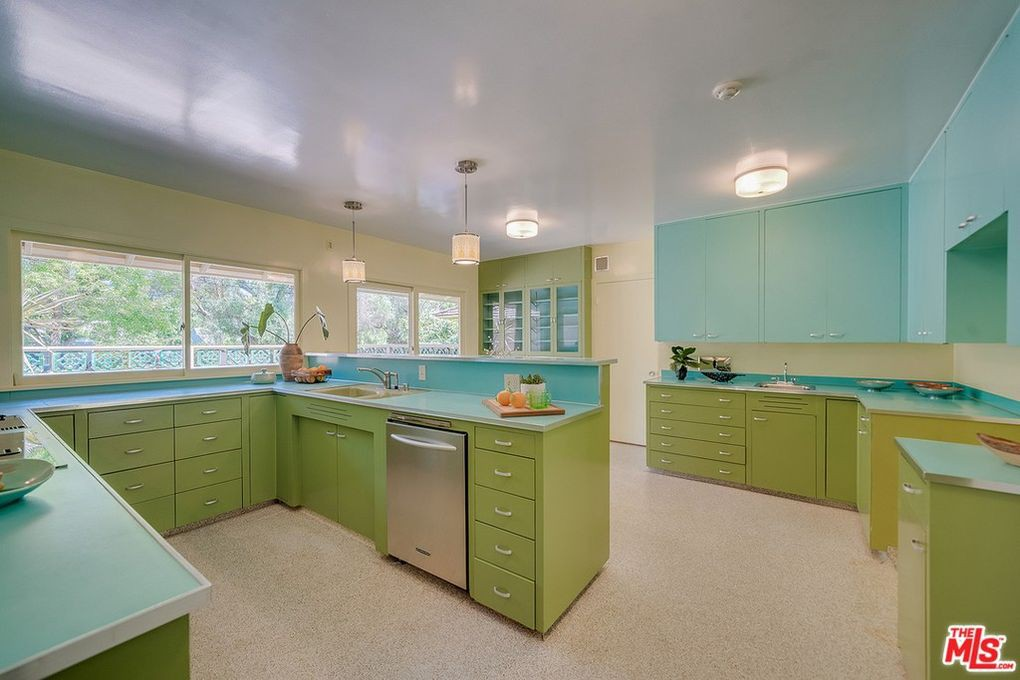 Kitchen with retro green cabinets