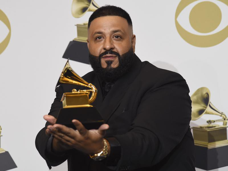 DJ Khaled poses in the press room with a Grammy