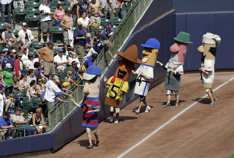 Racing sausages get ready to run during a baseball game