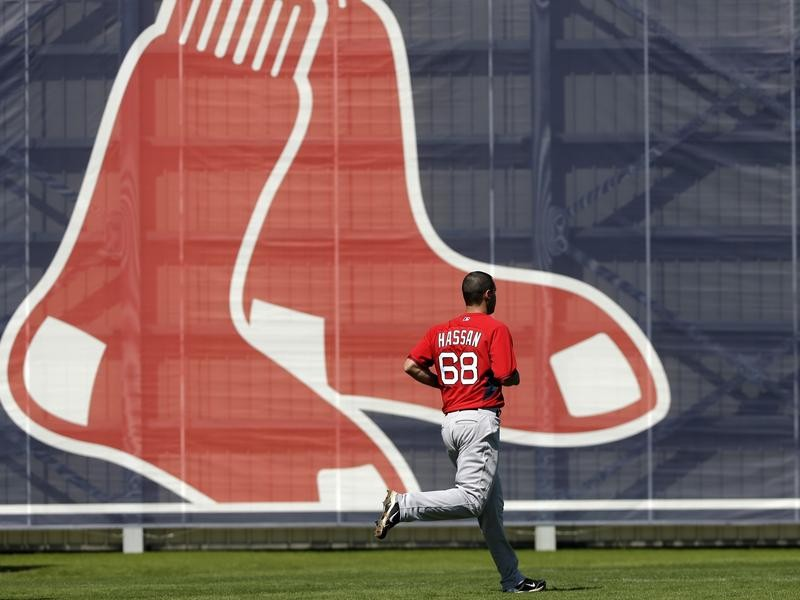 Hassan Runs by Large Red Sox Logo
