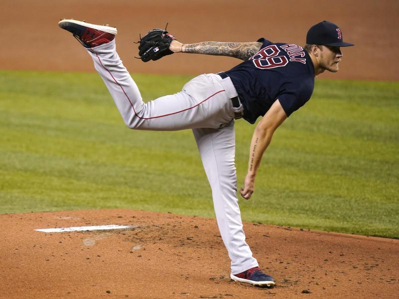 Boston Red Sox starting pitcher Tanner Houck follows through
