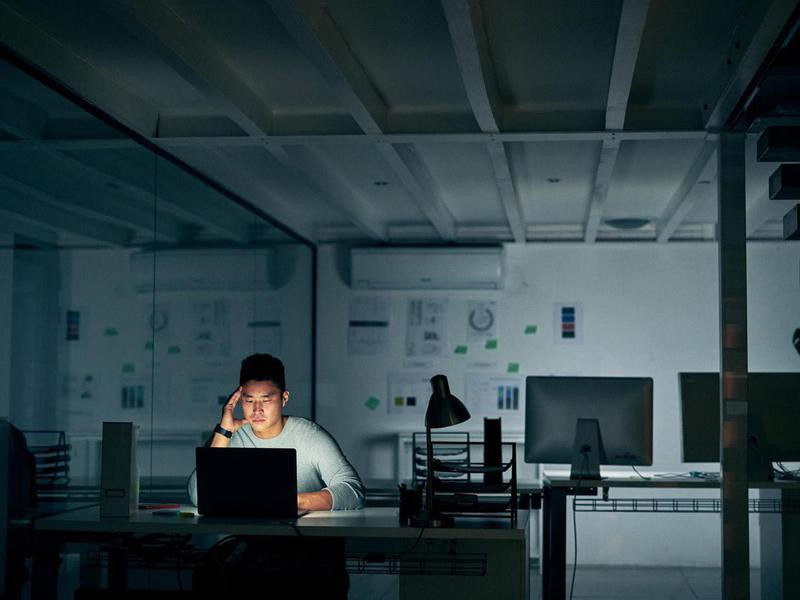 stressed man working in office