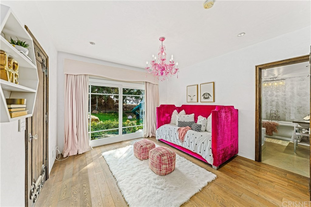 Pink couch with pink chandelier