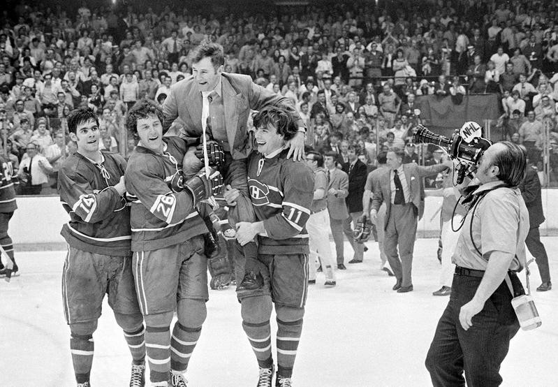 Montreal Canadiens coach Al McNeil carried by players