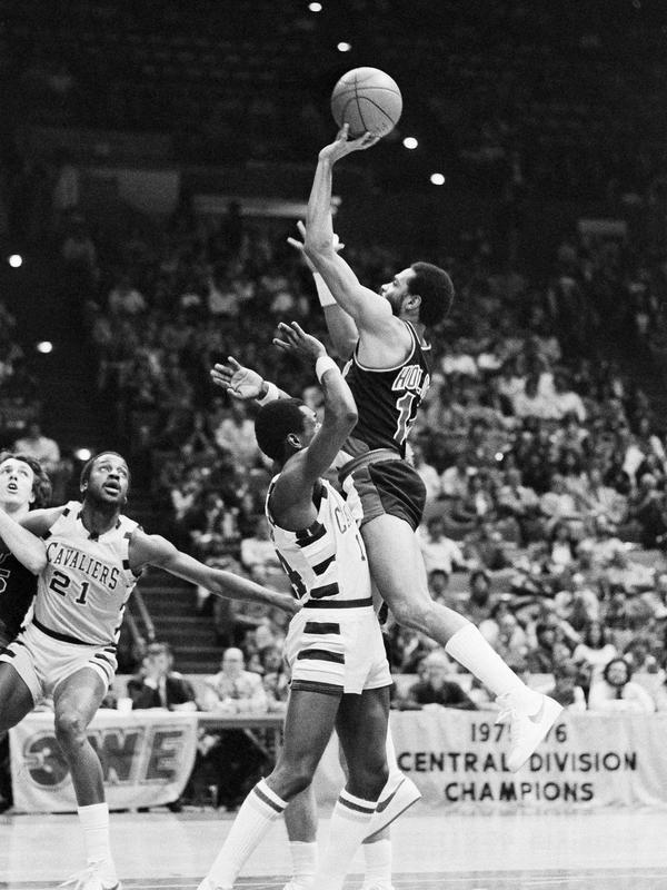 Lionel Hollins attempts jump shot