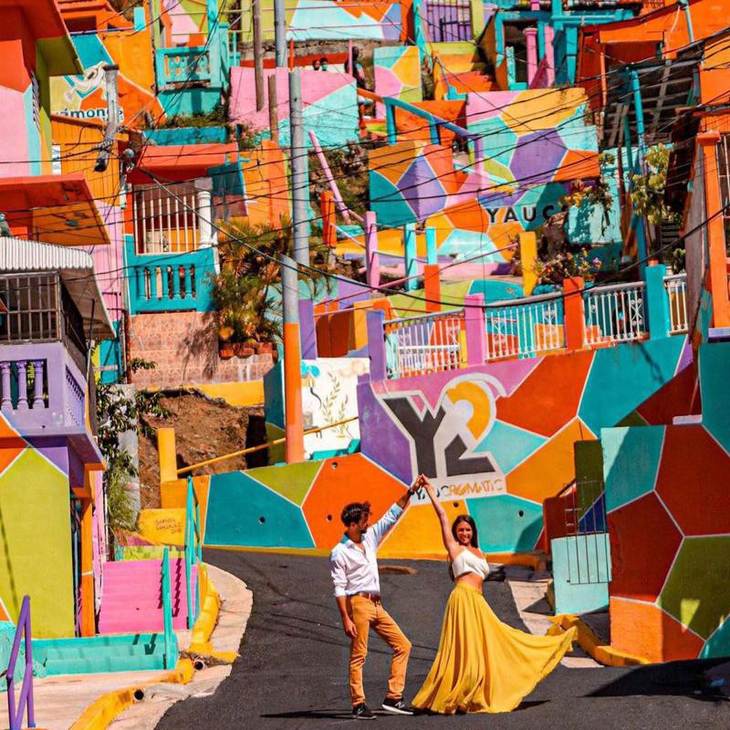 Danni and Fede dancing in colorful street
